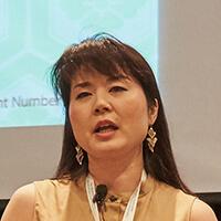 Dr. Megumi Okugiri speaking at a women's leadership event