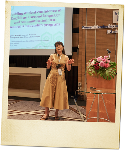 Megumi speaking at a leadership conference