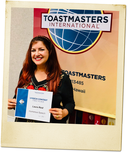 Laura Reid with certificate from First Place at Toastmasters